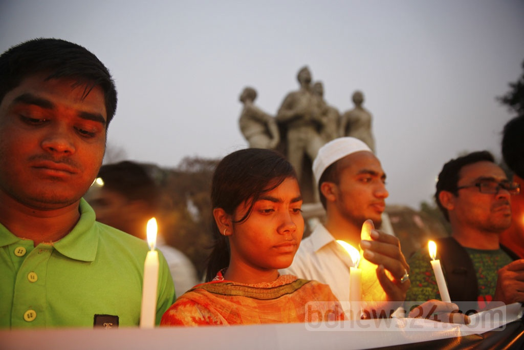 Several organisations held a candlelight vigil at Dhaka University's TSC on Tuesday in remembrance of the 49 people who died in the US-Bangla Airlines plane crash in Nepal on Monday.