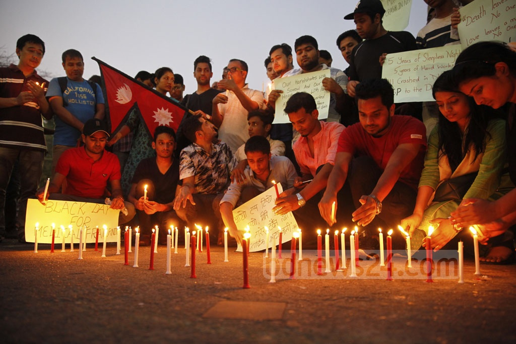 Nepali students from different universities in Bangladesh in a candlelight vigil at Dhaka University's TSC on Tuesday to remember the 49 people who died in the US-Bangla Airlines plane crash in Kathmandu on Monday. The deceased included 11 Nepali students who were returning home after graduating from a Bangladeshi medical college.
