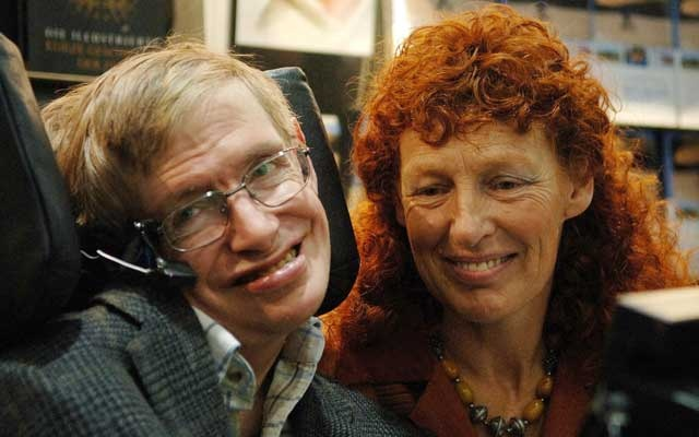 British astrophysicist Professor Stephen Hawking and his wife Elaine (R) visit the stand of German bookseller Rowohlt at the Frankfurt book fair, Oct 19, 2005. Reuters