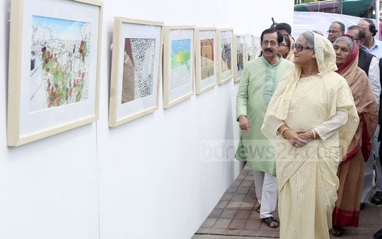 Prime Minister Sheikh Hasina visits a children's art exhibition, 'My Vision of March 7th', in Tungipara on Saturday.