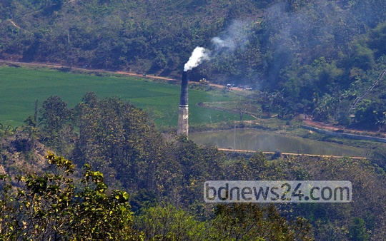 A brick kiln illegally constructed by influential people near a protected forestland in Bandarban's Roanchhari area, as viewed from a road through Chainga village. Photo: mostafigur rahman
