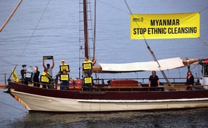 Protesters from Amnesty International display banners regarding the the Rohingya crisis in Myanmar as they sail a boat near the venue for the one-off summit of 10-member Association of Southeast Asian Nations (ASEAN) being held in Sydney, Australia, March 16, 2018. Reuters