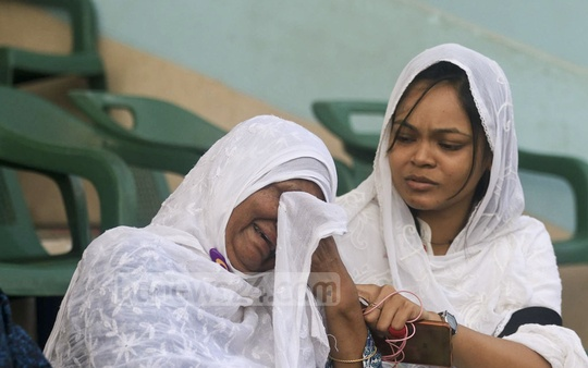 Grief-stricken relatives of the US-Bangla plane crash victims at the Bangladesh Army Stadium in Dhaka, where the bodies of the 23 victims were brought on Monday to pay the final respects before handover.