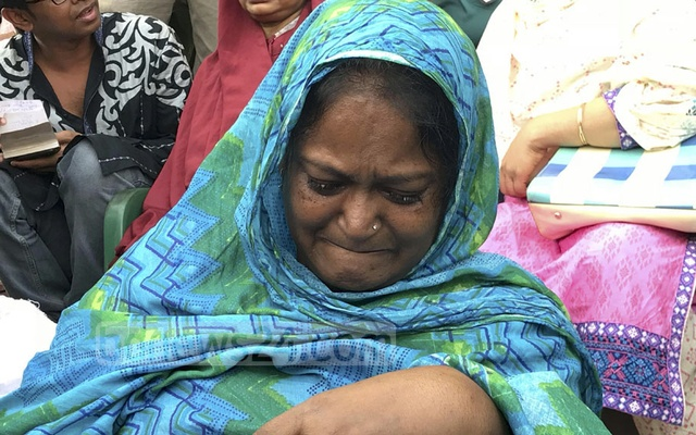 US-Bangla Airlines' First Officer Prithula Rashid's mother breaks down in tears as she waits for her daughter's body at the Bangladesh Army Stadium in Dhaka, where the bodies of the 23 victims were brought on Monday to pay the final respects before handover.