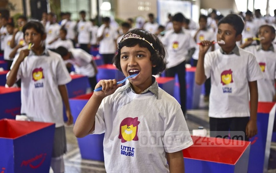 Children are seen taking part at the World Oral Health Day programme on Tuesday organised by toothpaste brand Pepsodent at Dhaka's Bangabandhu International Conference Centre.