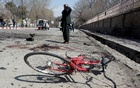 An Afghan man inspects the site of a suicide attack in Kabul, Afghanistan Mar 21, 2018. Reuters