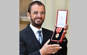 Ringo Starr, whose real name is Richard Starkey, poses after receiving his Knighthood at an Investiture ceremony at Buckingham palace in London, Britain, March 20, 2018. John Stillwell/Pool via Reuters