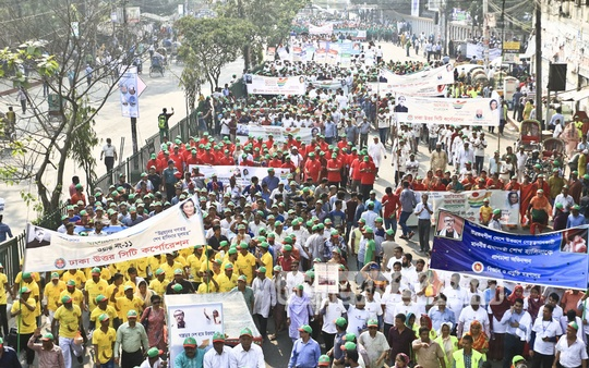 Public servants march in colourful processions in Dhaka on Thursday to join a function at Bangabandhu National Stadium as part of seven-day celebrations over Bangladesh becoming eligible to graduate from a least developed or LDC nation to a developing one.
