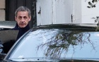 Former French President Nicolas Sarkozy enters his car as he leaves his house in Paris, France, Mar 21, 2018. Reuters