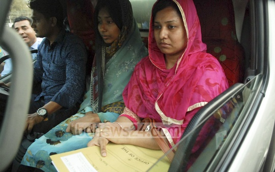 Members of Nazrul Islam's family take his body home from Dhaka's Shahjalal International Airport after the body of the Nepal plane crash victim arrived on Thursday.