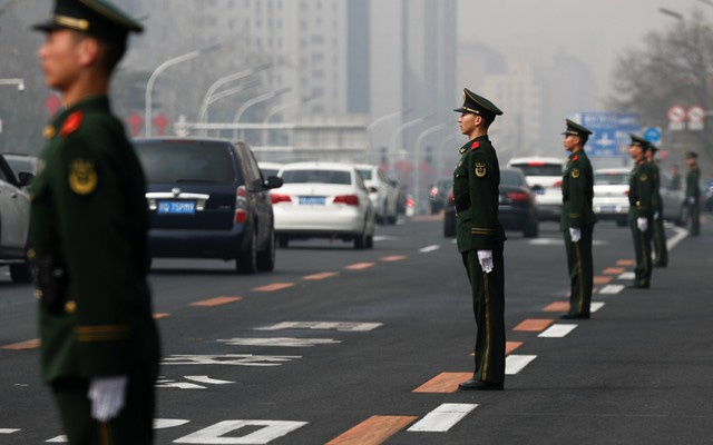 Security personnel take position along Beijing's main east-west thoroughfare, Changan Avenue, in Beijing, China March 27, 2018. Reuters