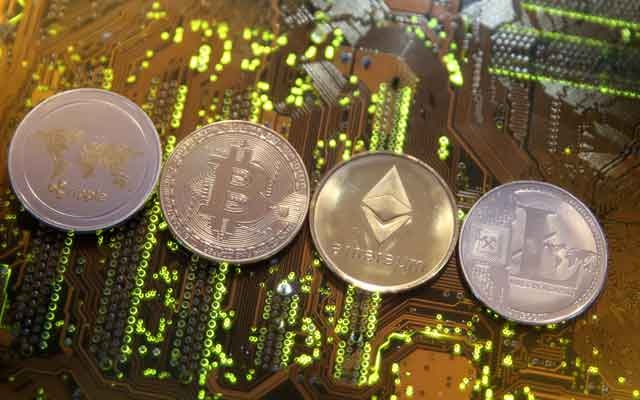 Representations of the Ripple, Bitcoin, Etherum and Litecoin virtual currencies are seen on a PC motherboard in this illustration picture, Feb 13, 2018. Reuters