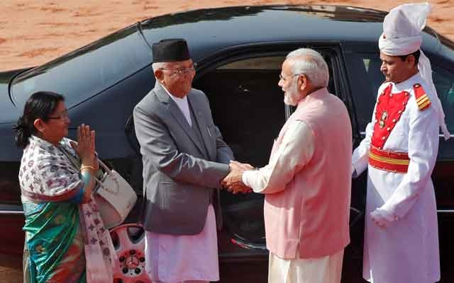 Nepal's Prime Minister Khadga Prasad Sharma Oli (2nd L) shakes hands with his Indian counterpart Narendra Modi (2nd R) as his wife Radhika Shakya Oli (L) gestures during Oli's ceremonial reception at the forecourt of India's Rashtrapati Bhavan presidential palace in New Delhi, India, Apr 7, 2018. Reuters