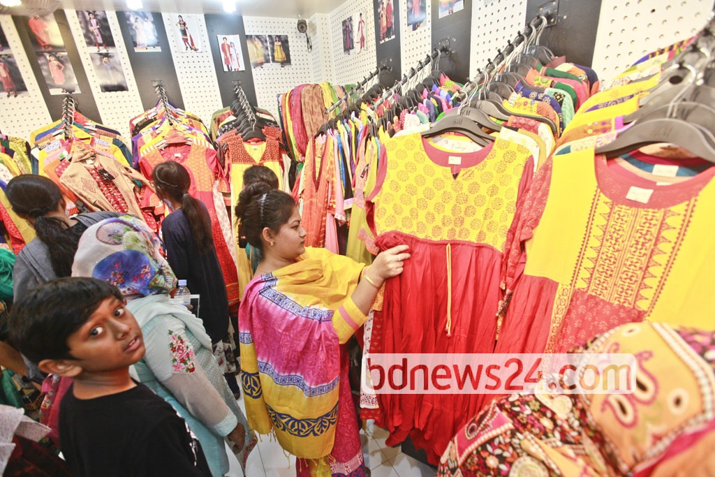 People browse through colourful clothes on the eve of Bengali New Year at Dhaka's Aziz Super Market. Photo: Abdullah Al Momin