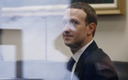 Facebook CEO Mark Zuckerberg is seen through reflective glass as he sits in the office of Senator Bill Nelson (D-FL) while he waits for a meeting in the Hart Senate Office Building in Washington, US, Apr 9, 2018. Reuters