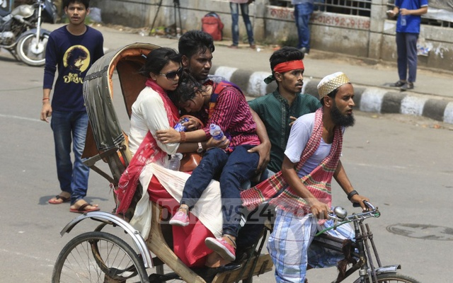 A student of Dhaka University is being taken to hospital by a rickshaw after she fell sick during the protests. Photo: Abdullah Al Momin