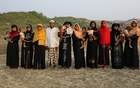 From left: Hasina Khatun, Marjan, Nurjan, Abdu Shakur, Shuna Khatu, Nurjan, Rahama Khatun, Amina Khatun, Settara, Hasina Khatun; relatives of ten Rohingya men killed by Myanmar security forces and Buddhist villagers on Sept 2, 2017, pose for a group photo in Cox's Bazar, Bangladesh, Mar 23, 2018. Reuters