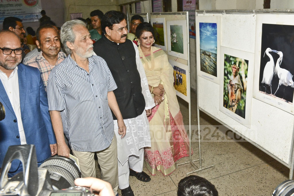 Visitors visit the Bangladesh National Photo Exhibition organised by the Bangladesh Photo Journalist Association at the National Press Club on Friday.