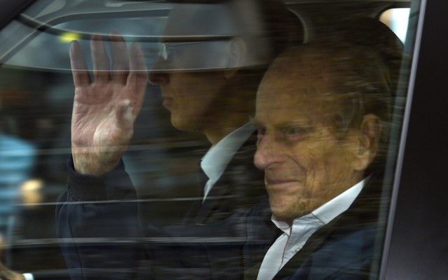 Britain's Prince Philip waves as he is driven away from King Edward VII's Hospital where he recently underwent hip replacement surgery, in central London, April 13, 2018. Reuters