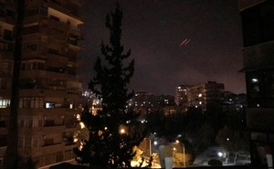 Anti-aircraft fire is seen over Damascus, Syria early Apr 14, 2018. Reuters