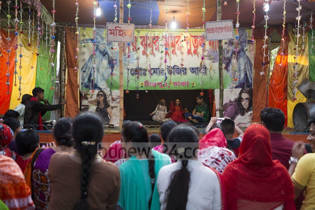 Visitors enjoying puppet show at the 10-day Baishakhi Mela that began at Bangla Academy premises on the first day of Baishakh, the first month in Bangla calendar. The picture is taken on Monday. Photo: Mostafigur Rahman
