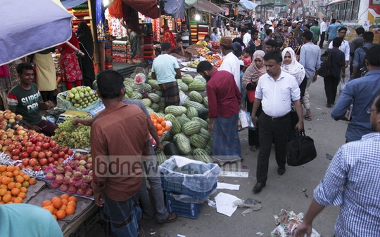 Pedestrians walk on the street at Abdullahpur in the capital's Uttara as vendors occupy the pavement.