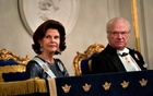 Sweden's Queen Silvia and King Carl Gustaf look on during the Swedish Academy's annual meeting at the Old Stock Exchange building in Stockholm, Sweden December 20, 2017. TT News Agency via REUTERS