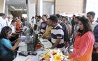 Visitors take a look at the products and services displayed at a three-day international tourism fair at Bangabandhu International Conference Centre in Dhaka on Thursday. Photo: Asif Mahmud Ove
