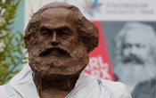 FILE PHOTO: Workers set up a bronze sculpture of Karl Marx in his hometown Trier, Germany, April 13, 2018. Reuters