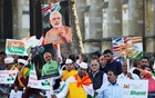 Demonstrators hold placards and pictures of India's Prime Minister Narendra Modi at Parliament Square in London on Apr 18. Reuters