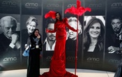 A woman poses at Saudi Arabia's first commercial movie theatre in Riyadh, Saudi Arabia April 18, 2018. Reuters