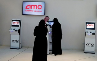 People buy tickets at Saudi Arabia's first commercial movie theater in Riyadh, Saudi Arabia April 18, 2018. Reuters