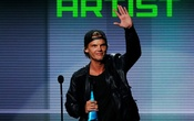 FILE PHOTO: Avicii accepts the favorite electronic dance music artist award at the 41st American Music Awards in Los Angeles, California November 24, 2013. Reuters