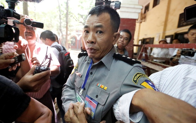Prosecution witness police captain Moe Yan Naing walks outside the court room during a hearing of detained Reuters journalists Wa Lone and Kyaw Soe Oo in Yangon, Myanmar Apr 20, 2018. Reuters