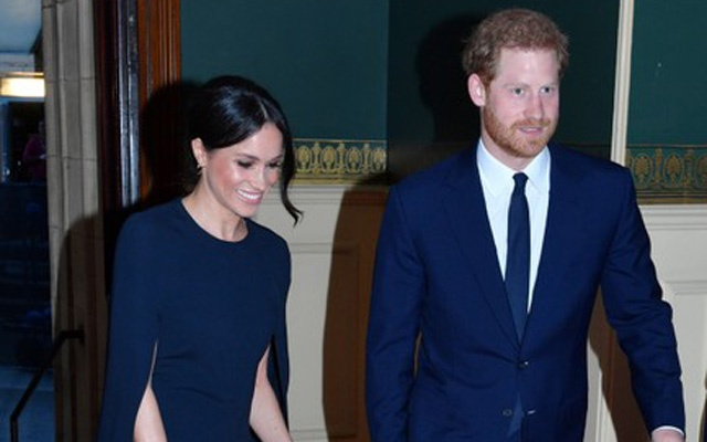 Britain's Prince Harry and Meghan Markle arrive for a special concert
