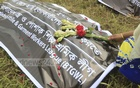 Relatives pay tributes to workers killed in the Rana Plaza disaster by placing wreaths at the graveyard at Jurain in Dhaka on Tuesday to mark the fifth anniversary of the country's biggest industrial disaster. Photo: Abdullah Al Momin
