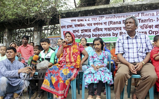 To mark the fifth anniversary of the Rana Plaza disaster, the National Garment Workers Federation and children of the victims remember the workers killed in the country's biggest industrial disaster by lighting candles in front of the National Press Club in Dhaka on Tuesday.