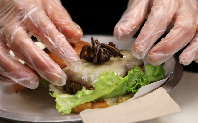 A tarantula burger is prepared at Bull City Burger and Brewery in celebration of Exotic Meat Month in Durham, North Carolina, US, April 16, 2018. Reuters