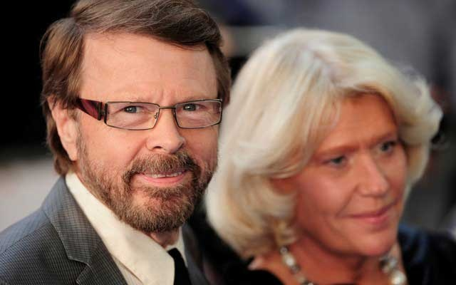 FILE PHOTO: Bjorn Ulvaeus, former member of Swedish pop group 'ABBA', and his wife Lena Kallersjo pose as they arrive for the world premiere of
