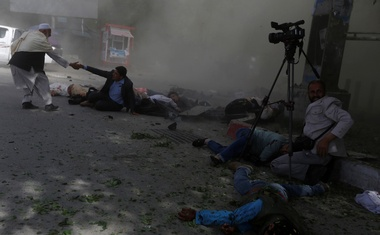 Afghan journalists are seen after a second blast in Kabul, Afghanistan April 30, 2018. Reuters