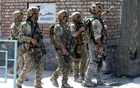 Afghan security forces arrive at the site of a suicide attack in Kabul, Afghanistan March 21, 2018. REUTERS