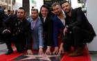 With fans aflutter, boy band 'NSync 'reunite' for Hollywood star