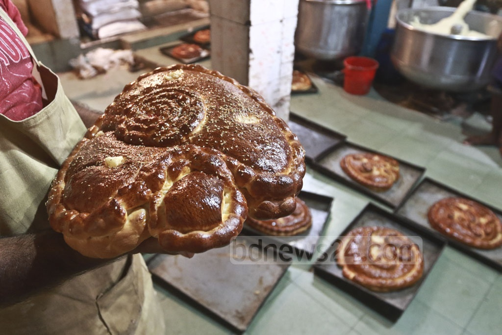 A man is preparing breads of various shapes on tge occasion of Shab-e-Barat in Dhaka's Nazimuddin Road.