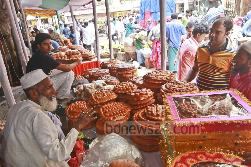 Customers crowd shops to buy breads on the occasion of Shab-e-Barat.