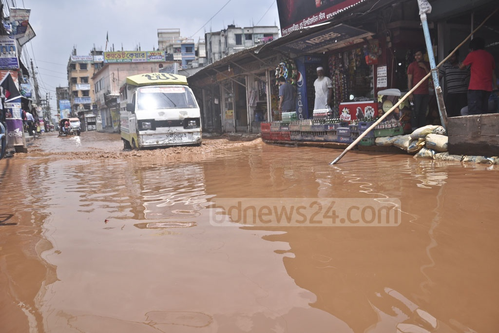 Dirty rainwater submerges a road in the Dogair neighbourhood in Demra after days of rains. Photo: Abdullah Al Momin