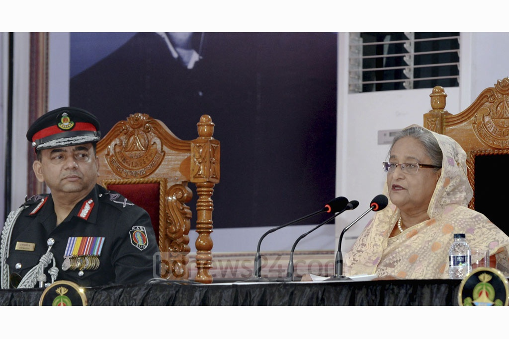 Prime Minister Sheikh Hasina addressing a founding anniversary programme of the Rapid Action Battalion at its Kurmitola headquarters in Dhaka on Thursday. Photo: PMO