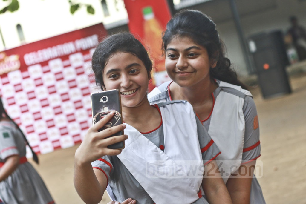 Students of Holy Cross School in Dhaka take selfie to capture the memorable moment after clearing the SSC examinations. Photo: Abdullah Al Momin