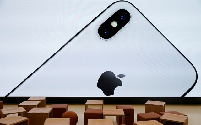 File Photo: An iPhone X is seen on a large video screen in the new Apple Visitor Center in Cupertino, California, US, Nov 17, 2017. Reuters