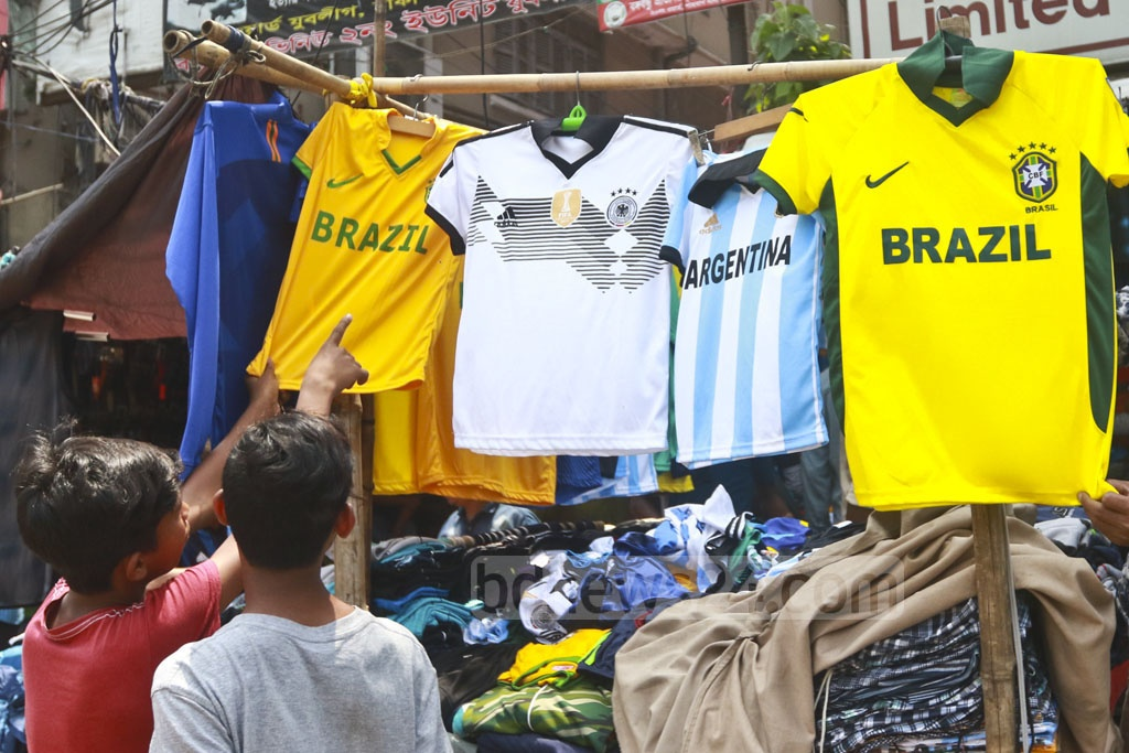 Vendors sell jerseys of different countries ahead of FIFA World Cup 2018 in Dhaka's Gulistan. Photo: Abdullah Al Momin