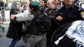 Israeli security forces personnel scuffle with a Palestinian woman ahead of the annual Jerusalem Day parade outside Jerusalem's Old City's Damascus Gate, May 13, 2018. REUTERS